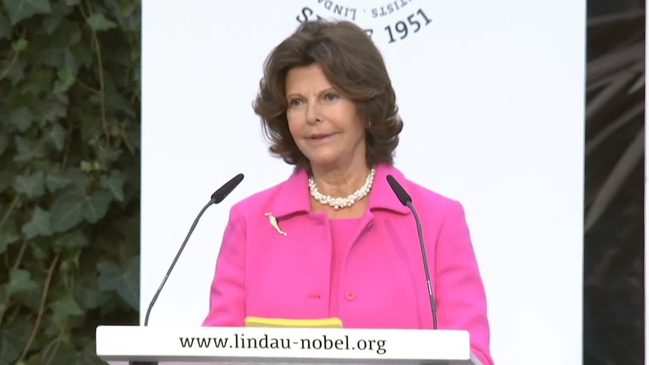Queen Silvia of Sweden (2014) - Queen Silvia of Sweden awarding economist Bing Wan with the Global Childhood Award.