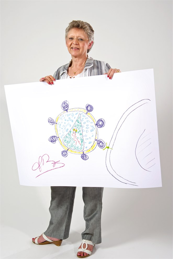 Francoise Barré-Sinoussi with a drawing of the HI virus.<br>