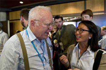 62nd Lindau Nobel Laureate Meeting, 2012 - Laureate John Hall (Physics, 2005) discussing with a young researcher