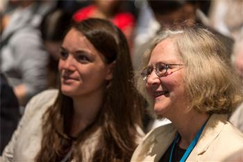 Elizabeth Blackburn  - Elizabeth Blackburn next to a young scientist at the 64th Meeting.