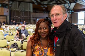 Peter Agre - Peter Agre next to a young scientist at the 64th Meeting.