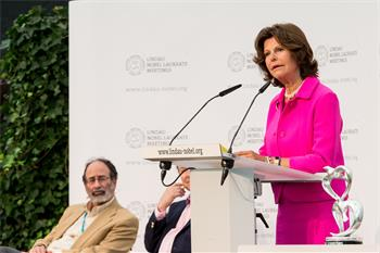Queen Silvia of Sweden	 - Queen Silvia of Sweden	delivering her welcome address at the closing panel discussion of the 5th Meeting on Economic Sciences on Mainau Island.