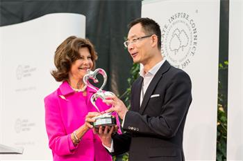 Queen Silvia of Sweden	 - Queen Silvia of Sweden	handing over the Global Childhood Award of the World Childhood Foundation to economist Bin Wan.
