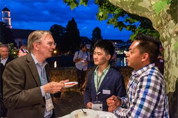 Jack Szostak - Jack Szostak conversing with young scientists at the 65th Lindau Nobel Laureate Meeting.