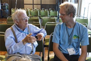 John Hall - John Hall conversing with a young scientist at the 65th Lindau Nobel Laureate Meeting.