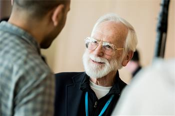 J. Michael Bishop - J. Michael Bishop talking to a young scientist at the 68th Lindau Nobel Laureate Meeting